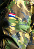 Camouflaged clothing. Of a Dutch soldier with flag Royalty Free Stock Photos
