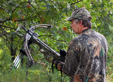 Camouflaged crossbow hunter. Hunter in camouflage holding a crossbow Stock Photo