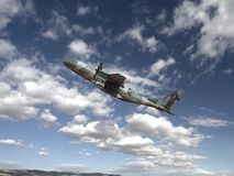 A camouflaged airplane, high-tech aircraft in flight royalty free stock images