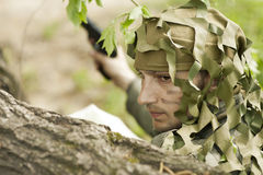 Camouflaged military man Stock Images