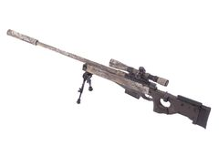 Camouflaged modern sniper rifle with scope Stock Photos