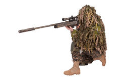 Camouflaged sniper in ghillie suit. Isolated Royalty Free Stock Photo
