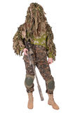 Camouflaged sniper in ghillie suit. Isolated Stock Photo