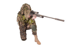Camouflaged sniper in ghillie suit. Isolated on white Royalty Free Stock Images