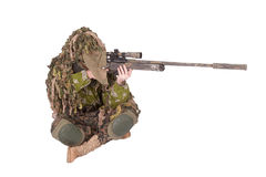 Camouflaged sniper in ghillie suit. Isolated on white Stock Image