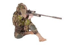 Camouflaged sniper in ghillie suit. Isolated on a white background Royalty Free Stock Images