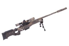 Camouflaged sniper rifle with scope Stock Photos