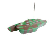 Camouflaged toy boat Royalty Free Stock Photography