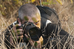Camouflaged war photojournalist. Stock Photo
