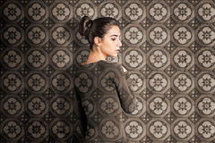 Camouflaging. Beautiful woman in camouflaging clothing Royalty Free Stock Image