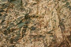 Camoufleer gevouwen document Stock Foto's