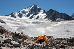 Camp. A tent is set up in a high mountain environment Stock Photos