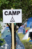 Camp. Sign with tents in the background Royalty Free Stock Photos
