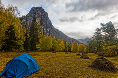 Camp in the autumn valley Royalty Free Stock Photo