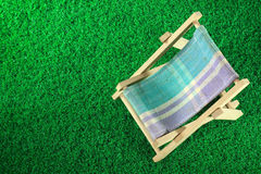 Camp bed. On green grass texture Stock Photo