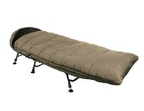 Camp bed with sleeping bag Royalty Free Stock Photography