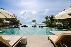 Camp Bed under the umbrella  on beach Phuket, Thailand Royalty Free Stock Image