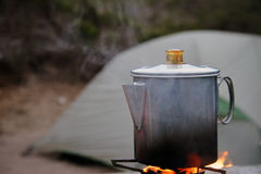 Camp coffee percolating. A classic camping percolator brews the morning coffee at the campsite stock photo