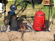 Camp Cooking. Cooking on an open fire with grill stock photography