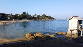 Camp Cove Bech, Sydney Harbour, Australia. A peaceful morning on the yellow sand beach at Camp Cove, Sydney harbour, NSW, Australia, with long early morning stock footage