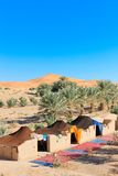 Camp in desert. A bedouin camp against one of the huge orange sand dunes in Erg Chebbi, Morocco Stock Photography