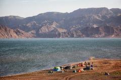 Camp beside desert mountain lake Stock Photos