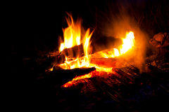 Camp fire. A night camp fire on black white nace yellow and orage flames Stock Images