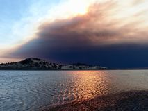 The Camp Fire as seen from Black Butte Lake. The Camp Fire as seen from Black Butte Lake near Orland, California Thursday morning, November 8, 2018. The most stock photos