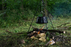 Camp fire black kettle pot soup cook vacation forest Royalty Free Stock Photography