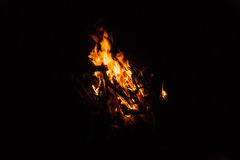 Camp fire burning in the night Stock Photos