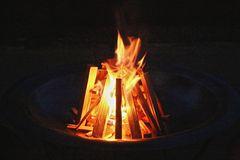 Camp fire. Flames and wood make a warm camp fire Stock Images