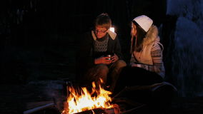 Camp Fire and Happy Couple. Night scape with campfire and young happy couple. stock video