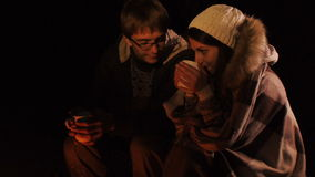 Camp Fire and Happy Couple. Night scape with campfire and young happy couple. stock video footage