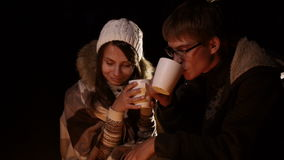 Camp Fire and Happy Couple. Night scape with campfire and young happy couple. stock footage