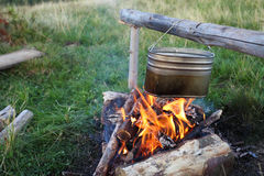 Camp fire and kettle Stock Photography