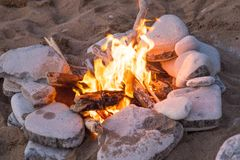 Camp Fire On Rock Beach Bonfire Royalty Free Stock Image