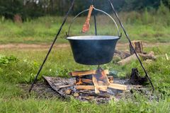 Camp fire outdoors burning with pot Stock Photo