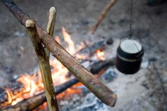 Camp-fire and pot. On it Royalty Free Stock Photo