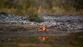 Camp Fire on the River Bank. In the mountains stock video