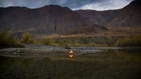 Camp Fire on the River Bank. In the mountains stock footage