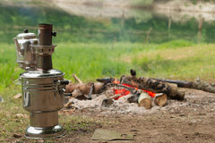 Camp fire and samovar Royalty Free Stock Photography