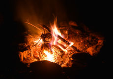 Camp fire. With stone, wood and coal in it at the summer night Stock Images