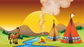 A camp fire and the sunset Royalty Free Stock Photography