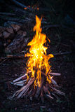 Camp fire at sunset Stock Photo