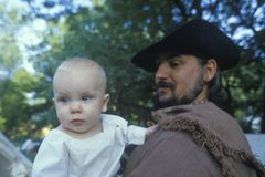 Camp follower with baby during historical Reenactment of Continental Army, Revolutionary War at Daniel Boon Homestead Stock Photos