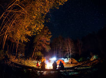 Camp in the forest with bonfire at night Royalty Free Stock Photography