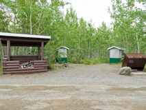 Camp ground firewood shed garbage bin outhouse Royalty Free Stock Photography