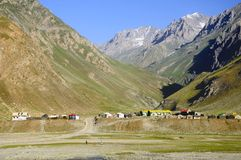 Camp and Himalayan mountain background Stock Photos