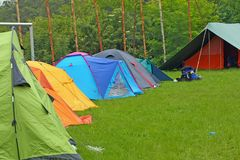 Camp with igloo tents scout campers in a green meadow. Camp with tents scout campers in a green meadow royalty free stock images