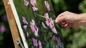 Camp international de peinture dans le delta de Danube banque de vidéos